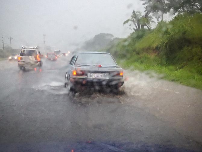 Car Spraying Water on the Freeway